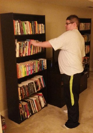 Corey with bookcases